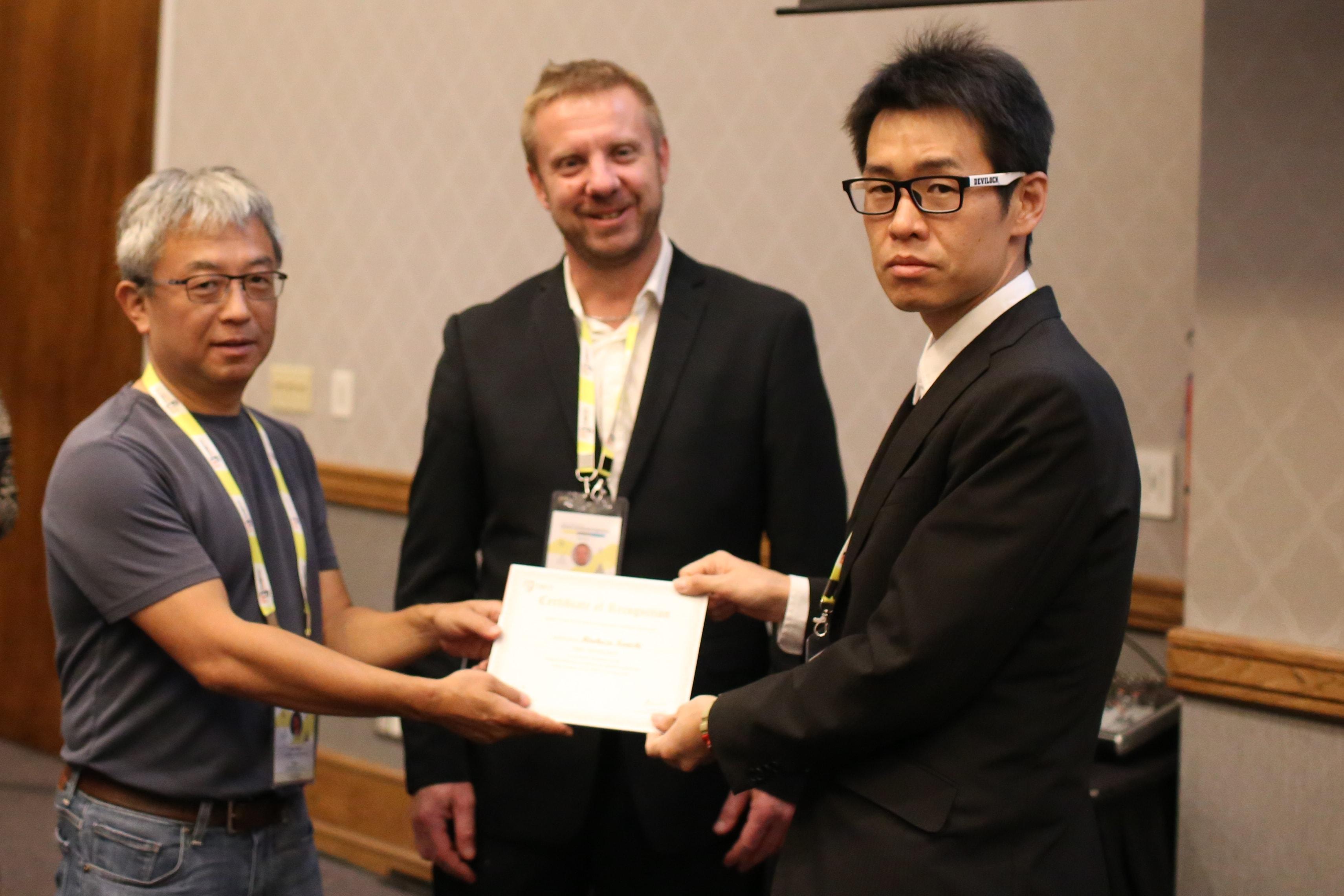 Hirokazu Konishi felicitated by Tadashi Ogitsu