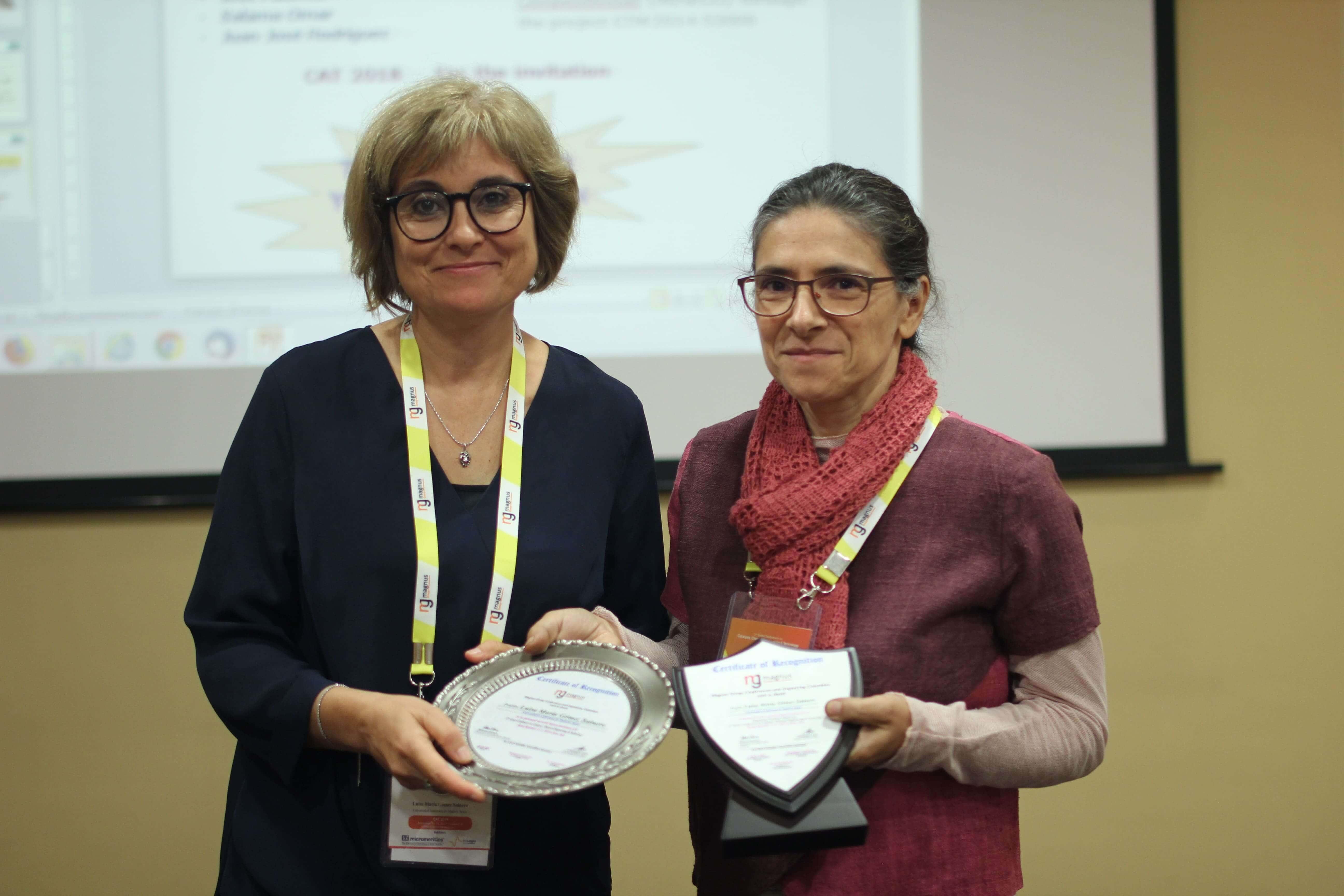 Luisa María Gómez Sainero felicitated by Valérie Meille