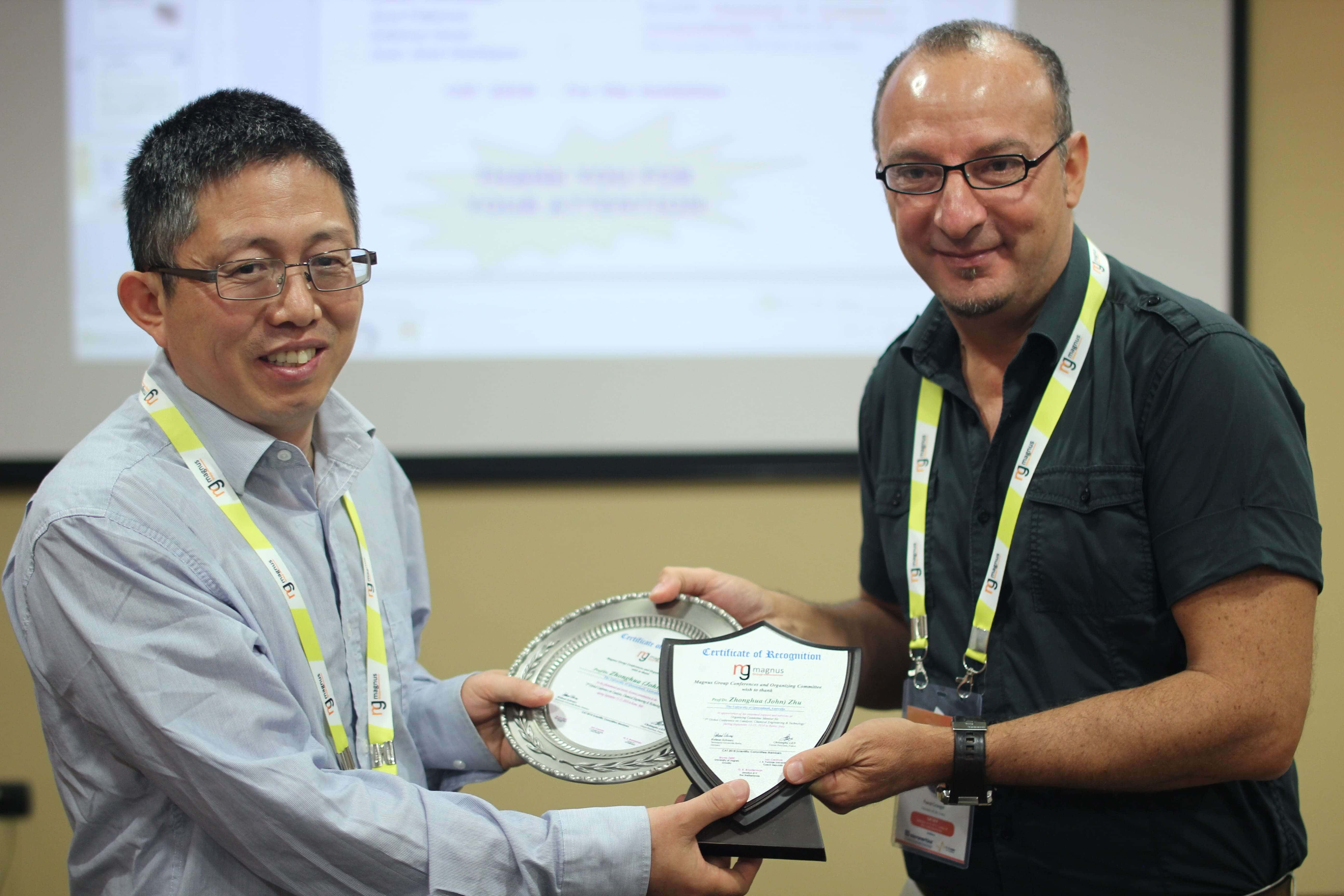 Zhonghua (John) Zhu felicitated by Pascal Granger
